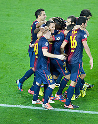 Lionel Messi is mobbed by his team mates after scoring the winning goal during the Group G UEFA Champions League match between FC Barcelona and Spartak Moscow at the Nou Camp, Barcelona, Spain 19th September 2012. Credit - Eoin Mundow/Cleva Media