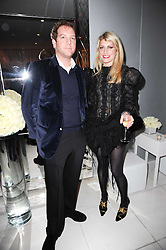 TOPPER MORTIMER and MEREDITH OSTROM at a party to celebrate Lancome's 10th anniversary of sponsorship of the BAFTA's in association with Harper's Bazaar magazine held at St.Martin's Lane Hotel, London on 19th February 2010.
