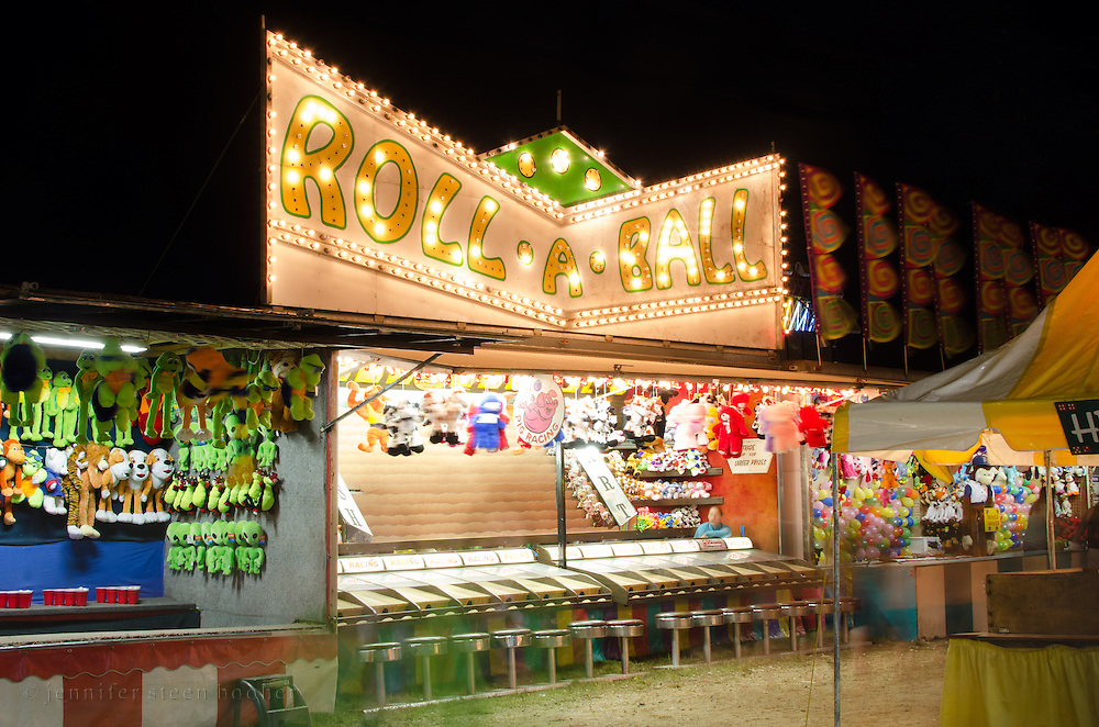 A long-exposure night shot at the midway of a traveling fair, Blue Hill, Maine.