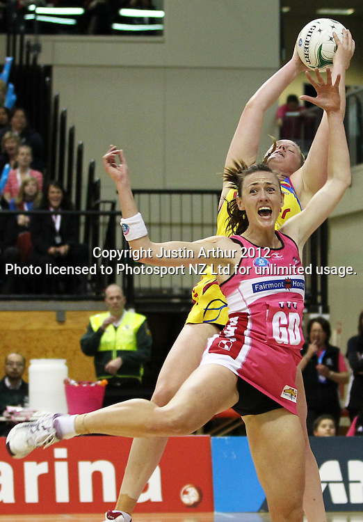 Thunderbirds' Rebecca Bulley and Pulse's Caitlin Thwaites compete for the ball during the ANZ Netball Championship, Haier Pulse v Adelaide Thunderbirds at TSB Bank Arena, Wellington, New Zealand on Monday 21 May 2012. Photo: Justin Arthur / photosport.co.nz