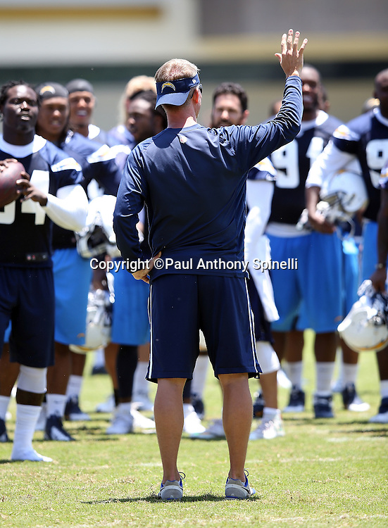 San Diego Chargers head coach Mike McCoy points as he talks to players during the San Diego Chargers Spring 2015 NFL minicamp practice on Wednesday, June 17, 2015 in San Diego. (©Paul Anthony Spinelli)