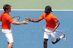 May 23, 2011; Stanford, CA, USA;  Jarmere Jenkins (right) celebrates with doubles partner Julen Uriguen (left) after a point during the semifinals of the men's team 2011 NCAA Tennis Championships at the Taube Family Tennis Center.