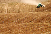Israel, Negev Desert, combine harvester wheat Harvesting, Long shot  May 2007