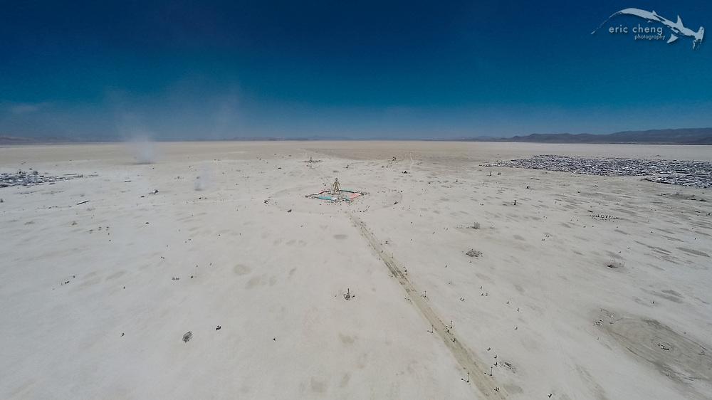 Aerial view of The Man with dust devils whirling on the playa. DJI Phantom 2, GoPro HERO 3+ Black. Burning Man 2014.