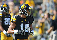 September 15 2012: Iowa Hawkeyes cornerback Micah Hyde (18) warms up before the start of the NCAA football game between the Northern Iowa Panthers and the Iowa Hawkeyes at Kinnick Stadium in Iowa City, Iowa on Saturday September 15, 2012. Iowa defeated Northern Iowa 27-16.