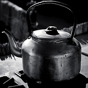 Image of a very seasoned overland water kettle.