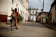 Couple of teenagers riding a bicycle in Remedios, Cuba Thursday July 17, 2008.