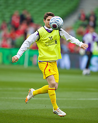 DUBLIN, REPUBLIC OF IRELAND - Wednesday, May 14, 2014: Liverpool's Joe Allen warms-up before a postseason friendly match against Shamrock Rovers at Lansdowne Road. (Pic by David Rawcliffe/Propaganda)