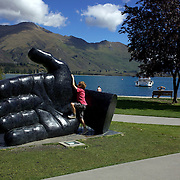 A young boy plays at the Lake Wanaka water front. Wanaka is  a year round destination set against the pristine alpine backdrop of Mount Aspiring National Park in Central Otago. South Island, New Zealand. 26th February 2011. Photo Tim Clayton