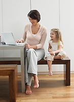 Mother showing daughter laptop