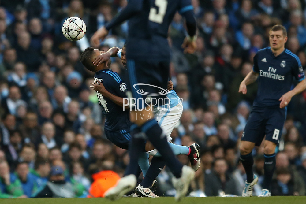 Manchester City midfielder Fernandinho (25)  catches Real Madrid midfielder Casemiro (14)  in the face during the Champions League match between Manchester City and Real Madrid at the Etihad Stadium, Manchester, England on 26 April 2016. Photo by Simon Davies.