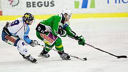 Derek Ryan (SAPA Fehervar AV19, #9) and Igor Cvetek (HDD Tilia Olimpija, #4) during ice-hockey match between HDD Tilia Olimpija and SAPA Fehervar AV19 at fourth match in Quarterfinal  of EBEL league, on Februar 26, 2012 at Hala Tivoli, Ljubljana, Slovenia. HDD Tilia Olimpija won 6:4. (Photo By Matic Klansek Velej / Sportida)