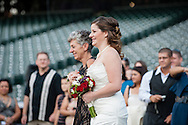 Paige Broska and Ralph Diaz are married at home plate at Coors Field in Denver, Colorado on Saturday, Sept. 29, 2012 with a reception at Maggiano's. (Christopher Lawson // Joshua & Co. Photography // www.joshuacophotography.com