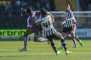 Notts County defender, on loan from Bradford City, Alan Sheehan fouls Plymouth Argyle forward Jake Jervis  during the Sky Bet League 2 match between Notts County and Plymouth Argyle at Meadow Lane, Nottingham, England on 11 October 2015. Photo by Simon Davies.