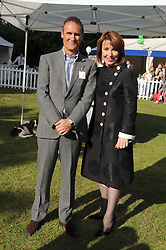KAY BURLEY and ADRIAN GILL at the Macmillan Dog Day in aid of Macmillan Cancer Support held at the Royal Hospital Chelsea, London on 8th July 2008.<br />