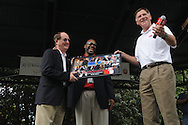 Ole Miss Sports Information Director Langston Rogers (left) is recognized for his 29 years of service to the university by Jamil Northcutt (center) and athletic director Pete Boone during Grove Bowl pre-game activities in the Grove at the University of Mississippi in Oxford, Miss. on Saturday, April 17, 2010.