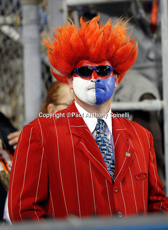 A Bengals fan with a painted face and sunglasses wears an orange wig prior to the NFL Pro Football Hall of Fame preseason football game between the Dallas Cowboys and the Cincinnati Bengals on Sunday, August 8, 2010 in Canton, Ohio. The Cowboys won the game 16-7. (©Paul Anthony Spinelli)