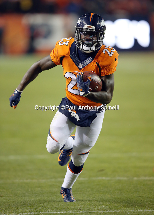 Denver Broncos running back Ronnie Hillman (23) looks for running room after catching a second quarter pass for a gain of 14 yards and a first down to the Cincinnati Bengals 7 yard line with less than two minutes left before halftime during the 2015 NFL week 16 regular season football game against the Cincinnati Bengals on Monday, Dec. 28, 2015 in Denver. The Broncos won the game in overtime 20-17. (©Paul Anthony Spinelli)