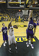 January 12 2010: Northwestern Wildcats guard Michael Thompson (22) puts up a shot as Iowa Hawkeyes forward Devon Archie (35) looks on during the first half of an NCAA college basketball game at Carver-Hawkeye Arena in Iowa City, Iowa on January 12, 2010. Northwestern defeated Iowa 90-71.