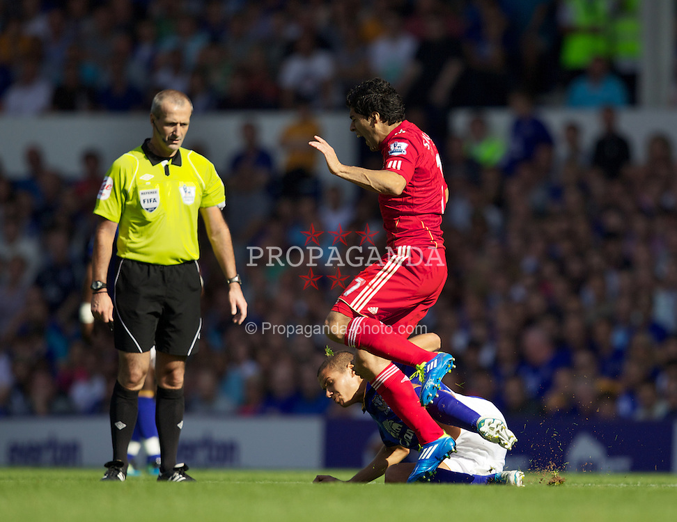 LIVERPOOL, ENGLAND - Saturday, October 1, 2011: Everton's Jack Rodwell tackles Liverpool's Luis Alberto Suarez Diaz under the nose of referee Martin Atkinson, and is shown the red card, during the Premiership match at Goodison Park. (Pic by Vegard Grott/Propaganda)