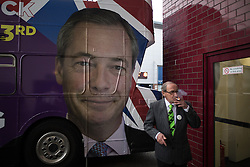 """© Licensed to London News Pictures . 25/05/2016 . Bolton , UK . A supporter smoking a cigarette at the event . Nigel Farage , Kate Hoey and Paul Nuttall at a """" We Want Our Country Back """" public meeting in favour of the UK leaving the EU at the Premier Suite of Bolton Wanderers' Macron Stadium . Photo credit : Joel Goodman/LNP"""