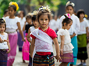 03 APRIL 2018 - CHIANG MAI, THAILAND: A school girl rehearses a cultural dance with other girls and women in Chiang Mai. Songkran is the traditional Thai New Year festival and is celebrated April 13-15. The holiday is best known for raucous water fights but it is an important cultural and religious holiday.       PHOTO BY JACK KURTZ