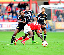 Bristol City's Jay Emmanuel-Thomas challenges Crewe Alexandra's Anthony Grant - Photo mandatory by-line: Dougie Allward/JMP - Tel: Mobile: 07966 386802 19/10/2013 - SPORT - FOOTBALL - Alexandra Stadium - Crewe - Crewe V Bristol City - Sky Bet League One
