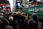 20th January 2009, the inauguration of President Obama..Time stands still as Americans unite at Time Square, New York City, to watch the jumbotrons with hope and joy as the 1st African-American President of USA takes the oath to lead the country through difficult times...Image © Arsineh Houspian/Falcon Photo Agency