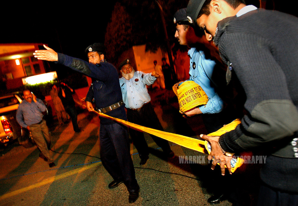 ISLAMABAD, PAKISTAN - MARCH 15: Police cordon off the area outside Luna Caprese restaurant after an explosion was set off amidst diners, on March 15, 2008, in Islamabad Pakistan. One person has been killed in the blast and  several foreigners wounded in the restaurant that is frequented by foreigners. (Photo by Warrick Page)