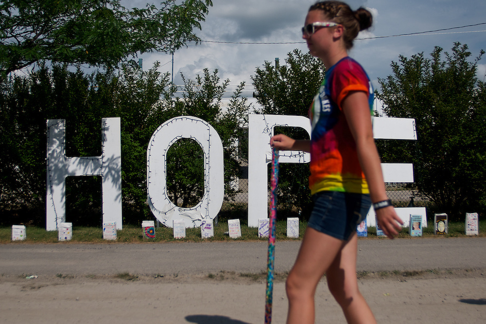 A Relay for Life walker passes by hope sign during the Bay County Relay for Life held at the Bay County Fair Grounds in Bay City, MI on Saturday July 22, 2011.     Lathan Goumas | The Bay City Times