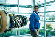 "AUBURN, AL – NOVEMBER 20, 2016: Ricardo Acevedo, plant manager at General Electric's Auburn facility, stands inside the newly built plant in Auburn's West Technology Park. Acevedo says GE chose Auburn in 2014 as their first site to use 3D printing to make high-volume products because it could count on an educated workforce and include the university as a partner in research. Currently GE is printing 50,000 jet engine nozzles a year using 30 3D printing machines, with intentions of doubling the machines in 2017. ""We need to understand the properties of the metal powder to get more consistent results,"" Acevedo said. <br /> <br /> In much of the United States, global trade and technological innovation has failed to produce the prosperity hoped for by political and business leaders. Yet despite formidable economic challenges, some localities are flourishing. In Lee County, Ala., unemployment is below the national average despite the loss of thousands of manufacturing jobs, and the key to the county's resilience may be Auburn University, which provided a steady source of employment during recessions and helped draw new businesses to replace those that fled. CREDIT: Bob Miller for The Wall Street Journal<br /> [RESILIENT]"
