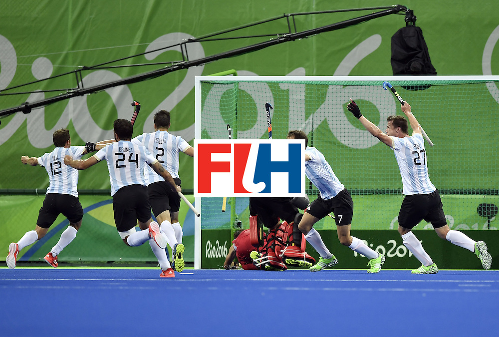 Argentina's players celebrate a goal during the men's Gold medal field hockey Belgium vs Argentina match of the Rio 2016 Olympics Games at the Olympic Hockey Centre in Rio de Janeiro on August 18, 2016. / AFP / PHILIPPE LOPEZ        (Photo credit should read PHILIPPE LOPEZ/AFP/Getty Images)