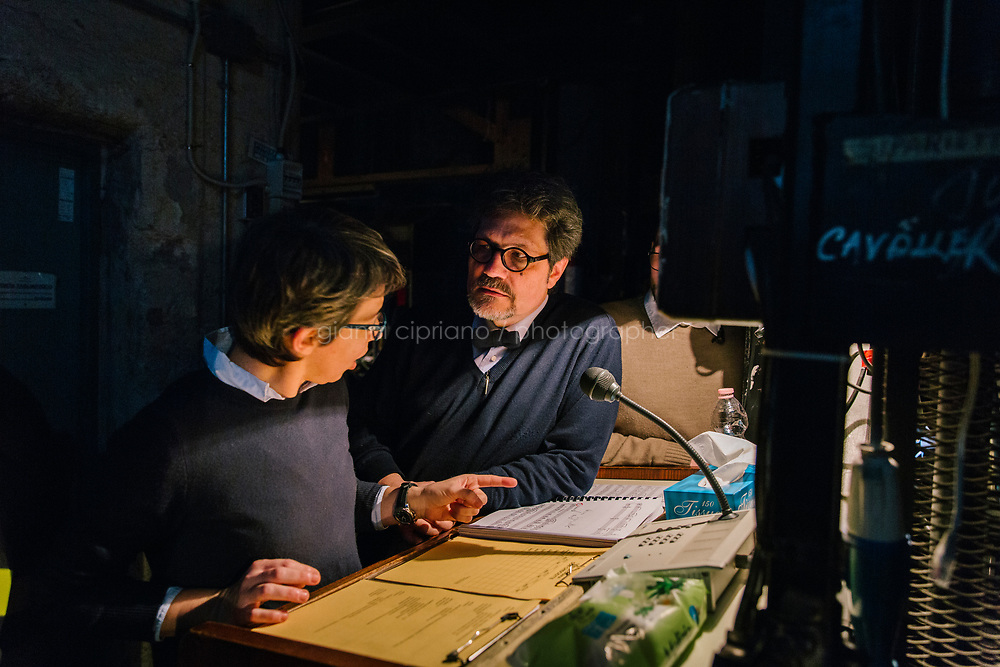 PALERMO, ITALY - 18 FEBRUARY 2018: (R-L) Stage manager Ludovico Rajata and orchestra operator Claudia Di Mattei discuss in the backstage during the dress rehearsal of &quot;Don Quixote&quot; at the Teatro Massimo in Palermo, Italy, on February 18th 2018.<br /> <br /> The Teatro Massimo Vittorio Emanuele is an opera house and opera company located  in Palermo, Sicily. It was dedicated to King Victor Emanuel II. It is the biggest in Italy, and one of the largest of Europe (the third after the Op&eacute;ra National de Paris and the K. K. Hof-Opernhaus in Vienna), renowned for its perfect acoustics. It was inaugurated in 1897.