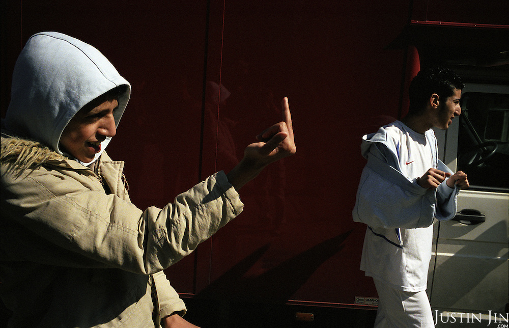 A Dutch-Moroccan teenager sticks up his middle finger at the De Meer pre-vocational school in Amsterdam..The school is pre-dominantly made up of kids of Turkish and Moroccan backgrounds.  ..Picture shot in Amsterdam in 2004 by Justin Jin. .