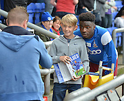 Devante Cole poses for a photograph with a fan  before the Sky Bet League 1 match between Oldham Athletic and Bradford City at Boundary Park, Oldham, England on 5 September 2015. Photo by Mark Pollitt.