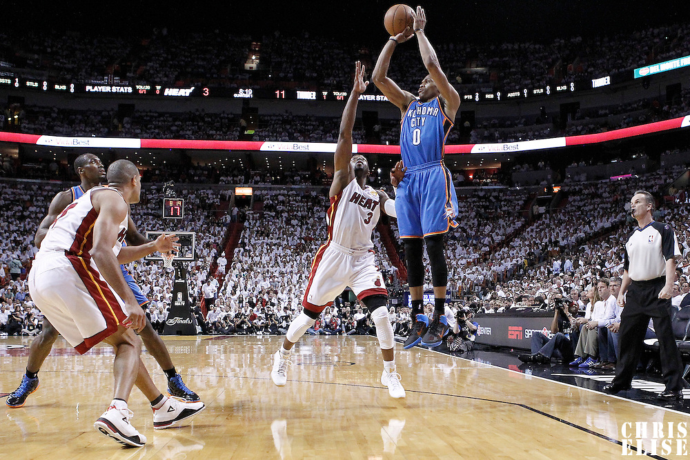 19 June 2012: Oklahoma City Thunder point guard Russell Westbrook (0) takes a jumpshot over Miami Heat shooting guard Dwyane Wade (3) during the first quarter of Game 4 of the 2012 NBA Finals, Thunder at Heat, at the AmericanAirlinesArena, Miami, Florida, USA.