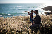Pascal Massimino, right, helps his four-year-old son Gaspard take photos in Gualala Point Regional Park in Gualala, Calif., on July 3, 2011.