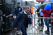 Brighton and Hove Albion manager Chris Hughton gets off the team bus in the pouring rain on arrival at the Vitality Stadium before the Premier League match between Bournemouth and Brighton and Hove Albion at the Vitality Stadium, Bournemouth, England on 15 September 2017. Photo by Graham Hunt.