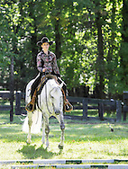 Middletown, NY - A female rider on her horse competes at the Middletown Rotary Horse Show at Fancher-Davidge Park on Sunday, Sept. 20, 2009.