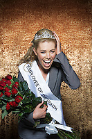 Woman screaming wearing Employee of the Month pageant paraphernalia against gold velvet background