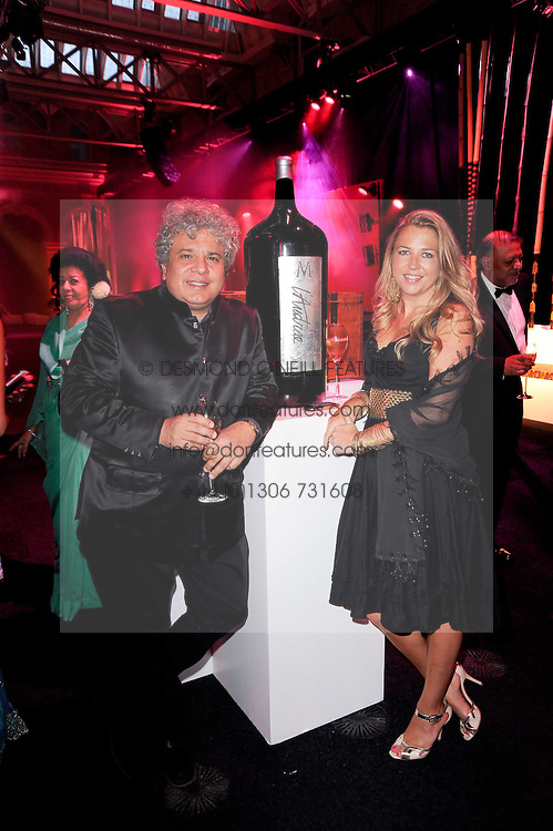 SUHEL SETH and AMANDA McLOUGHLIN at ARTiculate, Pratham UK Fundraising Gala held at The Old Billingsgate Market, City Of London on  11th September 2010 *** Local Caption *** Image free to use for 1 year from image capture date as long as image is used in context with story the image was taken.  If in doubt contact us - info@donfeatures.com<br /> SUHEL SETH and AMANDA McLOUGHLIN at ARTiculate, Pratham UK Fundraising Gala held at The Old Billingsgate Market, City Of London on  11th September 2010