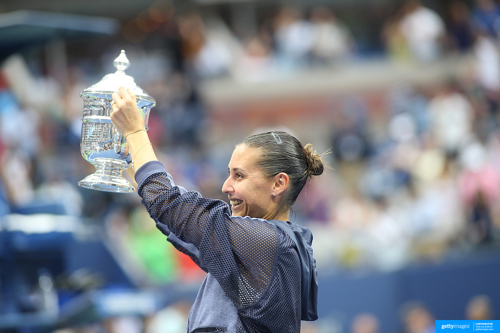 Flavia Pennetta, Italy, celebrates with the trophy as she shows it off to Italian Prime Minister Matteo Renzi, sat in the stands, after her victory against Roberta Vinci, Italy, in the Women's Singles Final match during the US Open Tennis Tournament, Flushing, New York, USA. 12th September 2015. Photo Tim Clayton