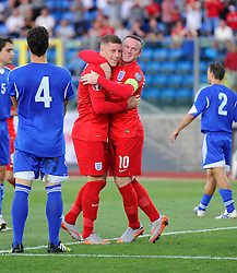 Ross Barkley of England (Everton) celebrates his goal with Wayne Rooney of England (Manchester United)  - Mandatory byline: Joe Meredith/JMP - 07966386802 - 05/09/2015 - FOOTBALL- INTERNATIONAL - San Marino Stadium - Serravalle - San Marino v England - UEFA EURO Qualifers Group Stage