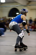 Taryn Hearts rounds a corner.  The San Diego Derby Dolls were at the Del Mar Fairgrounds in Del Mar, California on November 08, 2008.  The all-female roller derby league, founded in 2005, features serious competition among skaters with tongue-in-cheek names such as Anita Battle and Isabelle Ringer.