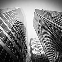 Black and white Chicago downtown city office buildings looking upward to the sky low angle view
