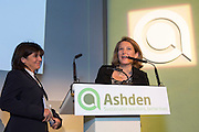 Sarah Butler-Sloss, Founder and Director of Ashden presenting flowers to Emma Freud  at  the 2015 Ashden Awards ceremony held at the Royal Geographical Society, London. UK.