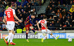 Lionel Messi of Barcelona fires a shot at goal  - Mandatory byline: Matt McNulty/JMP - 16/03/2016 - FOOTBALL - Nou Camp - Barcelona,  - FC Barcelona v Arsenal - Champions League - Round of 16