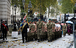 © London News Pictures. 10/11/2012. London, UK. Royal Marines from Commando 999  (Royal Marines who serve with the UK emergency services) entering Downing Street to meet  British Prime Minister David Cameron before taking part in a charity event in which the Royal Marines  speed march around London in record time to raise funds for wounded service personnel. The charity event takes place on Remembrance weekend.  Photo credit: Ben Cawthra/LNP