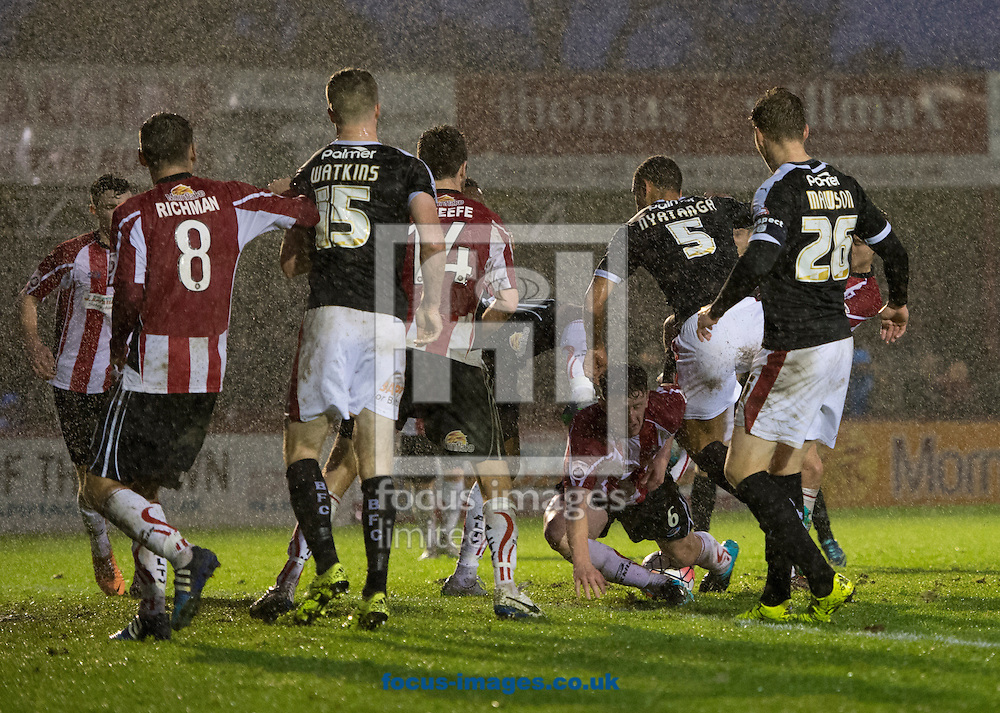 Scott Leather of Altrincham (6) falls over the ball in a goalmouth scramble in the final moments of the FA Cup match at Moss Lane, Altrincham<br /> Picture by Russell Hart/Focus Images Ltd 07791 688 420<br /> 07/11/2015