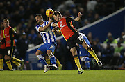 Birmingham City defender Jonathan Spector (23) beats Brighton central midfielder, Beram Kayal (7) to the header during the Sky Bet Championship match between Brighton and Hove Albion and Birmingham City at the American Express Community Stadium, Brighton and Hove, England on 28 November 2015.